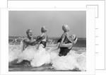 1970s 1960s Family Father Mother Holding Up A Twin Sons In The Ocean Surf by Corbis