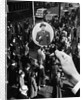 1930s 1940s Pedestrian Street Crowd Magnifying Glass Focused On Single Well Dressed Man by Corbis