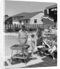 1950s Family In Backyard Beside Pool Having Cookout Of Hot Dogs and Hamburgers by Corbis