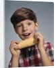 1960s Boy Eating Corn On The Cob by Corbis