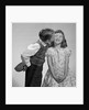 1950s 1960s Boy In Vest and Bow Tie Holding Valentine Candy Kissing Cheek Of Girl Making A Face by Corbis