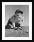 1950s 1960s Boy Playing Marbles Kneeling In The Dirt Squinting Missing A Front Tooth by Corbis
