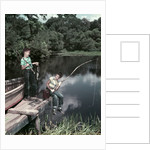 1950s Two Boys Fishing In Lake From Dock Outdoor by Corbis