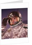 1960s Man Astronaut Lifting Up Visor Helmet Wearing Silver Navy Space Suit by Corbis