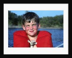 Young Boy Wearing Red Life Preserver by Corbis