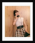 1950s 1960s Brunette Woman Talking Telephone Leaning Against Wood Panel Wall by Corbis