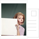 1960s Portrait Of Surprised Woman Peeking Around Sign Board by Corbis