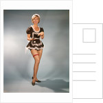 1960s Woman Wearing Short Black and White Lace French Maid Costume Pointing To Silver Tray by Corbis