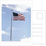 1960s American Flag On Pole Flying Against Blue Sky With Clouds by Corbis