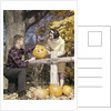 1960s Young Couple Man Woman In Autumn Woods Carving Halloween Jack-O-Lantern Pumpkin by Corbis