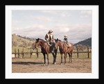 1970s Father And Son Sitting Together On Horses By Corral Wearing Hats by Corbis