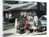 1950s 1960s Suburban Family Loading Ford Four Door Sedan Automobile For Trip by Corbis