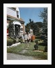 1940s 1950s Family Father Mother Daughter Son Leaving Suburban House Carrying Luggage by Corbis