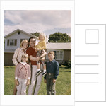 1960s Family In Front Of A Suburban Split Level House by Corbis