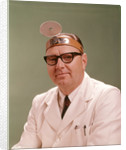 1950s 1960s Doctor Wearing Diagnostic Head Mirror On Forehead by Corbis