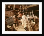 1960s Scientist Lab Technician Looking Into Oscilloscope In Laboratory by Corbis
