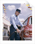1950s 1960s Service Station Attendant With Gasoline Pump Hose Filling Gas Tank Of Automobile by Corbis