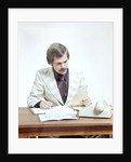 1970s Business Man At Desk Handling Paperwork Office Telephone by Corbis