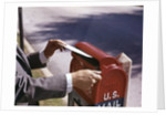 1960s Male Hand Dropping Letter Into U.S. Postal Mailbox Man Mailing Letter by Corbis