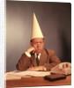 1960s Sad Depressed Businessman Wearing Dunce Cap by Corbis