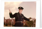 1960s Man Policeman Blowing Whistle Directing Traffic by Corbis