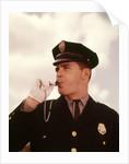 1960s Portrait Man Policeman Traffic Cop Blowing Whistle by Corbis