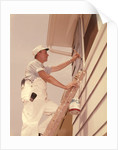 1950s 1960s Man House Painter Up Ladder Painting Window Shutter by Corbis