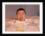 1960s Overwhelmed Screaming Bug-Eyed Man Drowning In Paper Work by Corbis