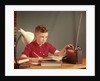 1960s Red Hair Boy Sitting At Deslistening To Portable Radio While Studying Homework by Corbis
