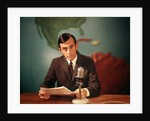 1960s Reporter Reading News Into Microphone With Global Map In Background by Corbis