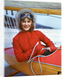 1940s Young Woman Sitting In Cockpit Of Ice Boat Holding Sheet Rope To Sail Boom by Corbis