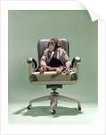 1970s Businessman Chimpanzee Sitting In Office Chair by Corbis