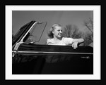 1930s 1940s Pretty Teenage Woman Sitting In Convertible Automobile Driver Seat by Corbis
