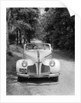 1940s 1941 Couple Man And Woman In Pontiac Convertible Driving On Country Lane In Countryside by Corbis