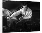 1950s Man Automotive Mechanic Servicing Car Engine by Corbis