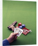 1970s Man Holding Royal Straight Flush In Spades Playing Cards with Semi-Automatic Pistol by Corbis