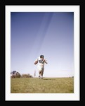 1960s Man Football Player Carrying Ball Running Towards Camera by Corbis