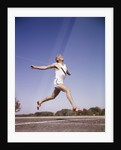 1960s Runner At Finish Line Breaking Through Tape by Corbis