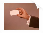 1960s 1970s Man Hand Holding Blank Business Card by Corbis
