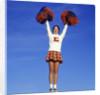 Teenage Girl Cheerleading by Corbis