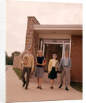 1960s Four Teenage Students Walking Out Of Suburban High School Building Carrying Books by Corbis