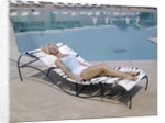 1960s Elegant Tall Woman In Bathing Suit Reclining On A Lounge Chair By Swimming Pool by Corbis