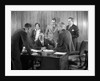 1930s Worried Business Group In Office Meeting Around The Boss' Desk by Corbis