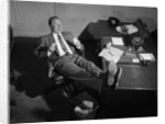 1950s Man Businessman Salesman Eating Lunch In Office With Feet Resting Up On Desk by Corbis