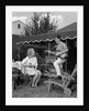 1960s Boy Playing Guitar, Woman Holding Soft Drink Bottle Outside In Backyard by Corbis