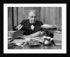 1920s 1930s Elderly Executive Man Sitting At Desk Looking Through Papers by Corbis