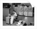1960s Man Programming Large Mainframe Computer Surrounded By Data Tape Drives Indoor by Corbis
