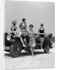 1920s 1930s Four Women In Dresses And Bathing Suits Gathered Around Convertible Touring Car At Seashore by Corbis