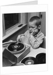 1960s 1970s Boy With Buzz Haircut Listening To Music On Portable 45 RPM Phonograph Record Player by Corbis