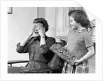 1950s Woman Mother Hands Covering Eyes As Girl Daughter Gives Her A Gift Present by Corbis
